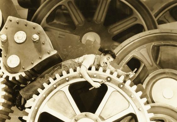 Charles Chaplin - cena do filme Tempos Modernos