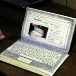 Animação: o notebook desenhado a caneta num caderno. E funciona!