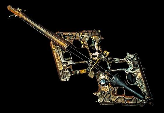 Guitarra com armas de fogo