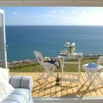Uma pequena casa de praia com vista deslumbrante para o mar