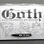O livro de colorir gótico com um único lápis de cera preto