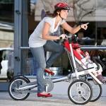 Carrinho de bebê equipado com bicicleta vira triciclo Taga a pedal