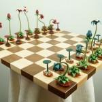 Jogo de xadrez origami com flores de papel dobrado