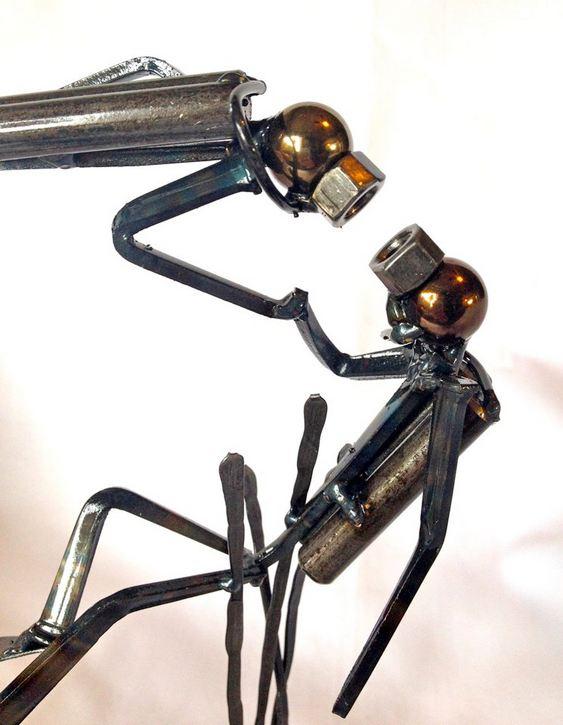 Escultura com sucata de ferro