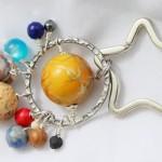 Lindo chaveiro e pulseira com os planetas do Sistema Solar