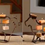 Castiçais de metal para velas com perfis de cães e gatos