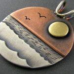 Pôr-do-sol em pingentes com tons e planos de prata, bronze e cobre