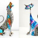 Esculturas de cão e gato em aço laqueado com cores vibrantes