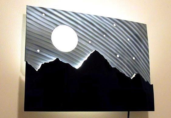 Quadro com paisagem de metal