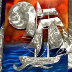Painel escultural em 3D de marina com veleiro ao pôr-do-sol