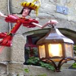 Cantoneira artística: boneco 'escala' parede para segurar lampião