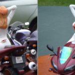 Motociclista sensual de macacão em miniatura esculpida à mão