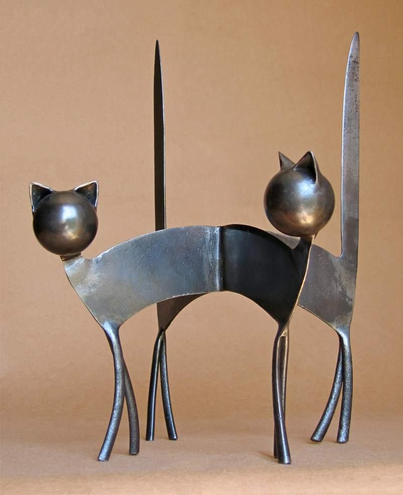 Rabos de gatos com facas