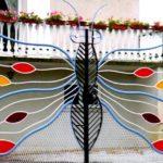 Portões de ferro franceses modelados como borboletas
