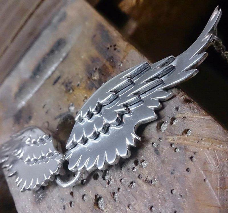 Fábrica de asas de anjo de metal