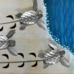 Painel 3D de metal com filhotes de tartarugas marinhas na praia